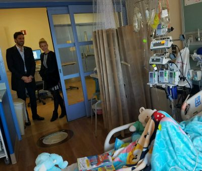 New York Rangers goaltender Henrik Lundqvist and his wife, Therese, talk with Marisa while standing inside the doorway of her hospital room on Christmas Day.