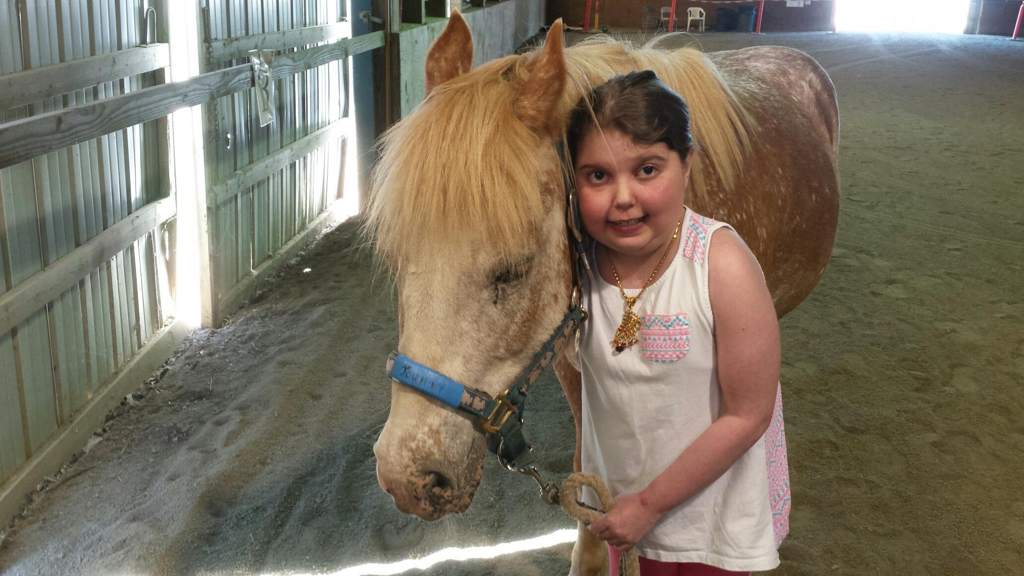 Marisa and Johnny at Special Strides Therapeutic Riding Center in Monroe Township